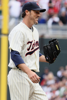 MINNEAPOLIS, MN - APRIL 08:  Closing pitcher Joe Nathan #36 of the Minnesota Twins celebrates the win during Opening Day on April 8, 2011 at Target Field in Minneapolis, Minnesota. The Minnesota Twins defeated the Oakland Athletics 2-1.  (Photo by Elsa/Ge