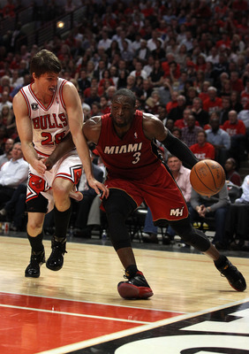 CHICAGO, IL - MAY 18:  Dwyane Wade #3 of the Miami Heat drives against Kyle Korver #26 of the Chicago Bulls in Game Two of the Eastern Conference Finals during the 2011 NBA Playoffs on May 18, 2011 at the United Center in Chicago, Illinois. NOTE TO USER: