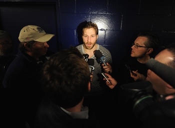 VANCOUVER, BC - MAY 16:  Ryane Clowe #29 of the San Jose Sharks speaks to media during the Stanley Cup Western Conference Finals practice at the Rogers Arena on May 16, 2011 in Vancouver, Canada.  (Photo by Harry How/Getty Images)