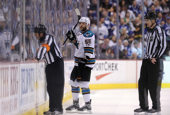 VANCOUVER, CANADA - MAY 18:  Ben Eager #55 of the San Jose Sharks goes to the penalty box after an unsportsmanlike conduct penalty for standing over goaltender Roberto Luongo #1 of the Vancouver Canucks (not in photo) and taunting him in the third period