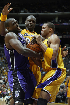 LOS ANGELES - APRIL 10:  Chris Webber #4 of the Sacramento Kings comes under pressure from Devean George #3 and Shaquille O'Neal #34 of the Los Angeles Lakers during the game on April 4, 2003 at Staples Center in Los Angeles, California.  The Lakers won 1
