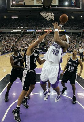 SACRAMENTO, CA - MAY 5:  Bonzi Wells #42 of the Sacramento Kings shoots over Tim Duncan #21 of the San Antonio Spurs in game six of the Western Conference Quarterfinals during the 2006 NBA Playoffs on May 5, 2006 at ARCO Arena in Sacramento, California.