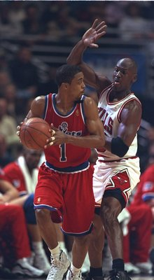 25 Apr 1997:  Rod Strickland of the Washington Bullets runs from Michael Jordan of the Chicago Bulls during their 98-86 loss to the Bulls in the NBA first round playoffs at United Center in Chicago, Illinois.  Mandatory Credit: Jonathan Daniel  /Allsport
