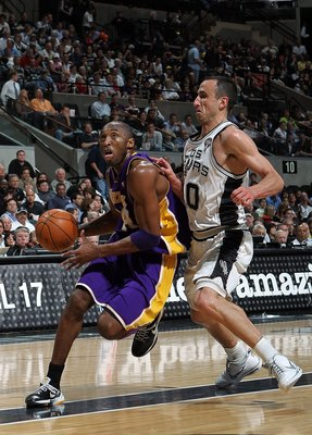 SAN ANTONIO - MARCH 24:  Guard Kobe Bryant #24 of the Los Angeles Lakers dribbles the ball past Manu Ginobili #20 of the San Antonio Spurs at AT&T Center on March 24, 2010 in San Antonio, Texas.  NOTE TO USER: User expressly acknowledges and agrees that,