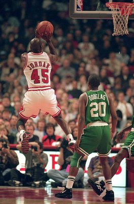 CHICAGO - MARCH 30:  Michael Jordan #45 of the Chicago Bulls jumps to shoot the ball during the game against the Boston Celtics at the United Center on March 30, 1995 in Chicago, Illinois. The Bulls defeated the Celtics 100-82.    NOTE TO USER: User expre