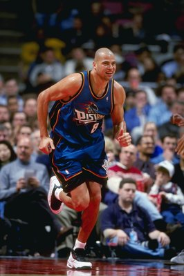 24 Mar 1999: Bison Dele #8 of the Detroit Pistons smiles as he runs down the court during a game against the New Jersey Nets at the Continental Airlines Arena in East Rutherford, New Jersey. The Piston defeated the Nets 84-71.