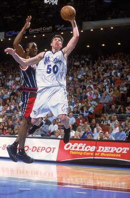 16 Feb 2001:  Mike Miller #50 of the Orlando Magic leaps for the basket during the game against the Houston Rockets at the Compaq Center in Houston, Texas.  The Magic defeated the Rockets 108-93.  NOTE TO USER: It is expressly understood that the only rig
