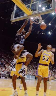 Orlando Magic center Shaquille O''Neal slam dunks over the Lakers'' James Edwards during the ''92-''93 season. Mandatory Credit: Ken Levine/ALLSPORT
