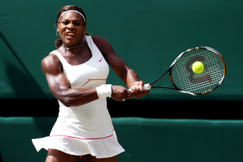 LONDON, ENGLAND - JULY 03:  Serena Williams of USA returns a shot during the Ladies Singles Final Match against Vera Zvonareva of Russia on Day Twelve of the Wimbledon Lawn Tennis Championships at the All England Lawn Tennis and Croquet Club on July 3, 20