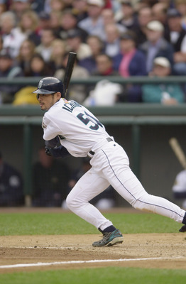 SEATTLE - OCTOBER 15:  Ichiro Suzuki #52 of the Seattle Mariners makes his way to first base during Game 2 of the American League Division Series against the Cleveland Indians on October 15, 2001 at Safeco Field in Seattle, Washington.  The Mariners won 5