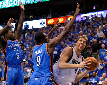 DALLAS, TX - MAY 17:  Dirk Nowitzki #41 of the Dallas Mavericks looks to shoot over Serge Ibaka #9 and Nate Robinson #3 of the Oklahoma City Thunder in Game One of the Western Conference Finals during the 2011 NBA Playoffs at American Airlines Center on M