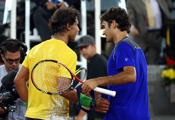 MADRID, SPAIN - MAY 07:  Roger Federer of Switzerland shakes hands with Rafael Nadal of Spain after Nadal won in 3 sets during day eight of the Mutua Madrilena Madrid Open Tennis on May 7, 2011 in Madrid, Spain.  (Photo by Julian Finney/Getty Images)