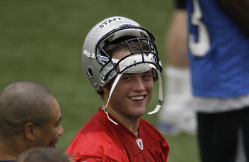 ALLEN PARK, MI - MAY 01:  Matt Stafford #9 of the Detroit Lions talks with teammates during rookie orientation camp at the Detroit Lions Headquarters and Training Facility on May 1, 2009 in Allen Park, Michigan.  (Photo by Gregory Shamus/Getty Images)