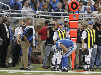 DETROIT - NOVEMBER 07:  Matthew Stafford #9 of the Detroit Lions bends over in pain against the New York Jets during the third quarter of the game at Ford Field on November 7, 2010 in Detroit, Michigan. The Jets defeated the Lions 23-20 in overtime.  (Pho