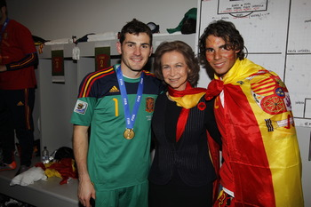 JOHANNESBURG, SOUTH AFRICA - JULY 11: Spain´s goalkeeper Iker Casillas (L-R), Spanish Queen Sofia and tennis player Rafa Nadal celebrates the victory in the Spanish dressing room after Spanish football tam won the 2010 FIFA World Cup at Soccer City Stadiu