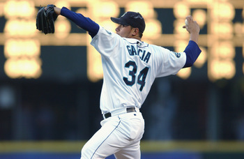 SEATTLE - AUGUST 30:  Pitcher Freddy Garcia #34 of the Seattle Mariners throws a pitch during the MLB game against the Kansas City Royals on August 30, 2002 at Safeco Field in Seattle, Washington.  The Royals defeated Mariners 5-1.  (Photo by Otto Greule