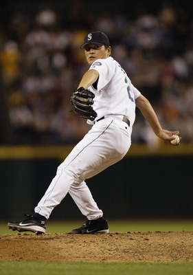 SEATTLE - AUGUST 13:  Kazuhiro Sasaki #22 of the Seattle Mariners pitches against the Toronto Blue Jays in the eighth inning of the game on August 13, 2003 at Safeco Field in Seattle, Washington.  Sasaki retired the side in order as the Mariners defeated
