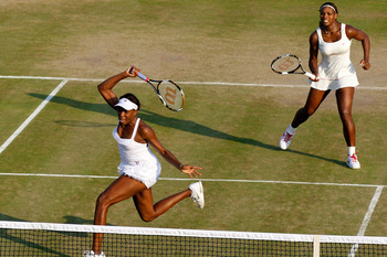 LONDON, ENGLAND - JUNE 25:  Serena Williams of USA (R) and Venus Williams of USA in action during their doubles match against Dominika Cibulkova of Slovakia and Anastasia Pavlyuchenkova of Russia on Day Five of the Wimbledon Lawn Tennis Championships at t