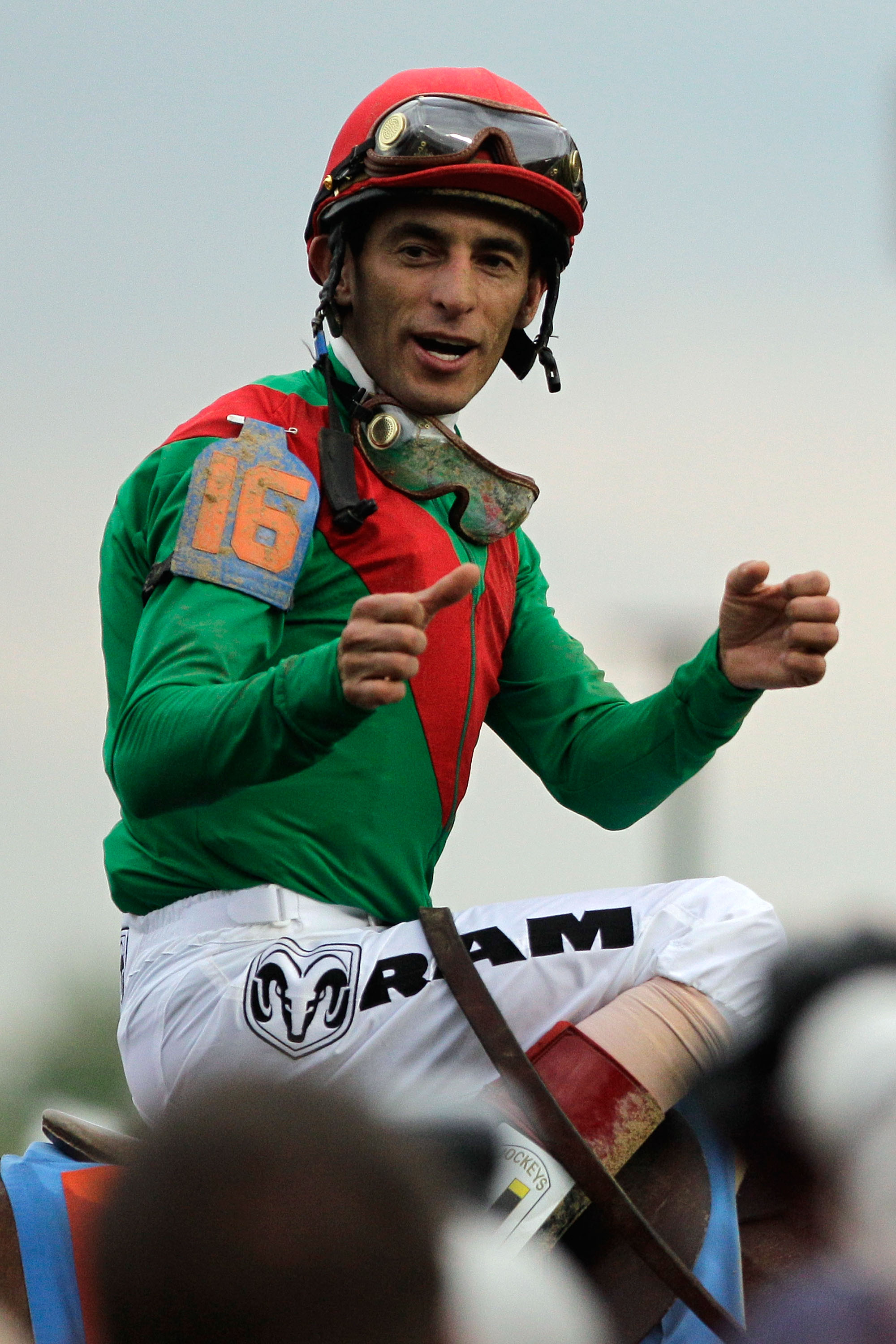 LOUISVILLE, KY - MAY 07:  Jockey John Velazquez, riding Animal Kingdom #16, celebrates winning the 137th Kentucky Derby at Churchill Downs on May 7, 2011 in Louisville, Kentucky.  (Photo by Rob Carr/Getty Images)
