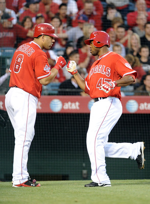 ANAHEIM, CA - MAY 25:  Howard Kendrick #47 of the  Los Angeles Angels celebrates his run with Kendry Morales #8 for a 5-0 lead over the Toronto Blue Jay during the second inning at Angel Stadium on May 25, 2010 in Anaheim, California.  (Photo by Harry How