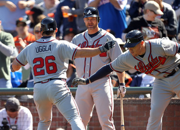 SAN FRANCISCO, CA - APRIL 24:  Dan Uggla #26 of the Atlanta Braves is congratulated by Freddie Freeman #5 and David Ross #8 after he hits a a home run to tie the game 6-6 in the eighth inning at AT&T Park on April 24, 2011 in San Francisco, California.  (
