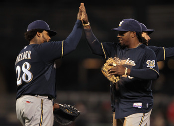PITTSBURGH, PA - APRIL 13:  Prince Fielder #28 (L)of the Milwaukee Brewers high-fives his teammate Rickie Weeks #23 after defeating the Pittsburgh Pirates 6-0 at PNC Park on April 13, 2011 in Pittsburgh, Pennsylvania.  (Photo by Scott Halleran/Getty Image