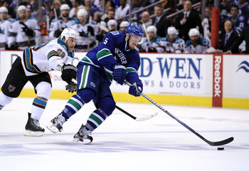 Christian Ehrhoff skates away from Ryan Clowe during Game 1 of the Western Conference Final