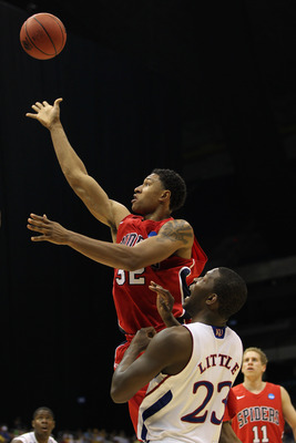 SAN ANTONIO, TX - MARCH 25:  Justin Harper #32 of the Richmond Spiders puts up a shot against Mario Little #23 of the Kansas Jayhawks during the southwest regional of the 2011 NCAA men's basketball tournament at the Alamodome on March 25, 2011 in San Anto