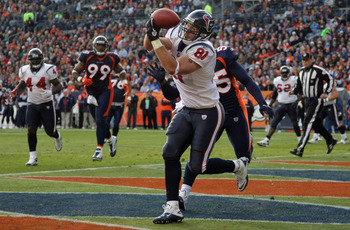 DENVER - DECEMBER 26:  Wide receiver Owen Daniels #91 of the Houston Texas makes a first quarter touchdown reception in front of D.J. Williams #55 of the Denver Broncos at INVESCO Field at Mile High on December 26, 2010 in Denver, Colorado. The Broncos de