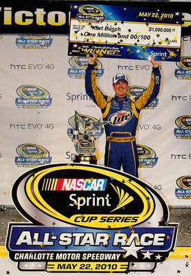 CONCORD, NC - MAY 22: Kurt Busch, driver of the #2 Miller Lite Dodge, celebrates in Victory Lane after winning the NASCAR Sprint All-Star Race at Charlotte Motor Speedway on May 22, 2010 in Concord, North Carolina.  (Photo by Geoff Burke/Getty Images for