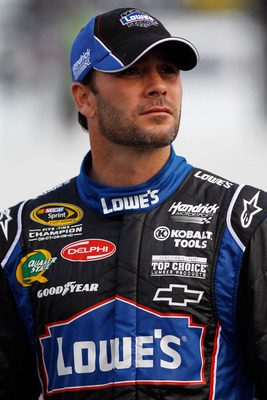 RICHMOND, VA - APRIL 29:  Jimmie Johnson, driver of the #48 Lowe's Chevrolet, stands on pit road during qualifying for the NASCAR Sprint Cup Series Crown Royal Presents The Matthew & Daniel Hansen 400 at Richmond International Raceway on April 29, 2011 in