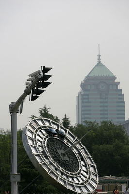 BEIJING, CHINA - JULY 13: (CHINA OUT) Workers install an Olympic parterre featuring a compass at a road on July 13, 2008 in Beijing, China. Beijing is making its final preparations for the Olympic Games, less than a month ahead of the big event. Over 1 mi