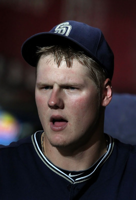 PHOENIX - SEPTEMBER 01:  Starting pitcher Mat Latos #38 of the San Diego Padres in the dugout during the Major League Baseball game against the Arizona Diamondbacks at Chase Field on September 1, 2010 in Phoenix, Arizona. The Diamondbacks defeated the Pad