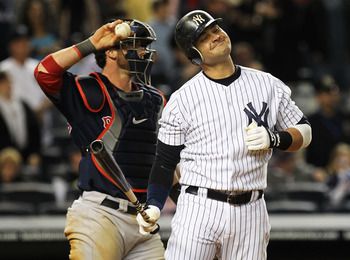 NEW YORK, NY - MAY 13:  Nick Swisher #33 of the New York Yankees reacts after striking out with two men on base against the Boston Red Sox during the eighth inning of their game on May 13, 2011 at Yankee Stadium in the Bronx borough of New York City.  (Ph