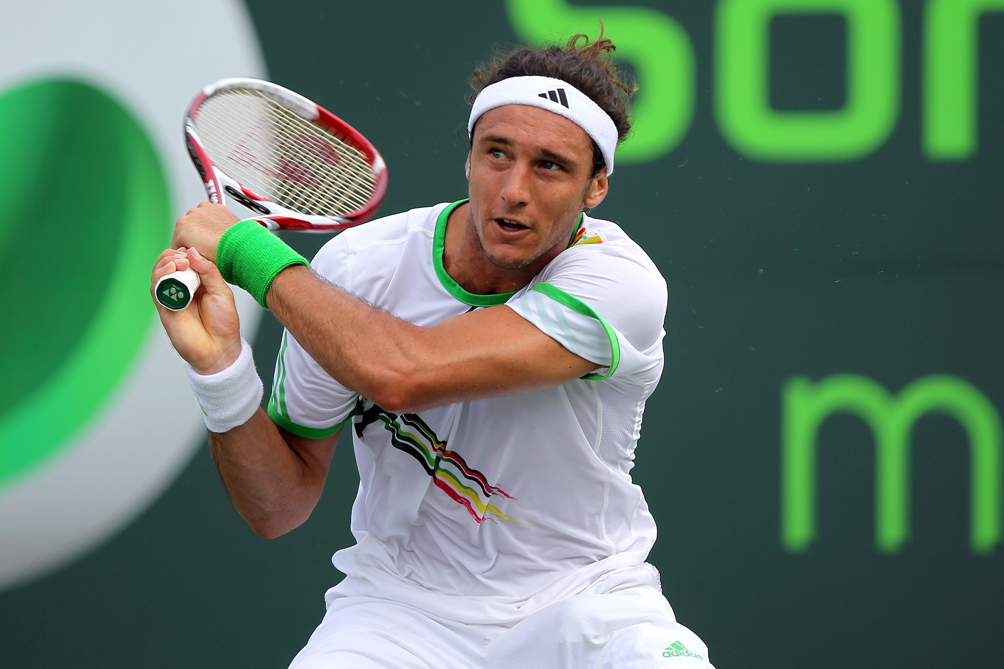 KEY BISCAYNE, FL - MARCH 28:  Juan Monaco of Argentina follows through on a return against Roger Federer of Switzerland during the Sony Ericsson Open at Crandon Park Tennis Center on March 28, 2011 in Key Biscayne, Florida.  (Photo by Mike Ehrmann/Getty I