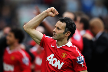 BLACKBURN, ENGLAND - MAY 14:  Ryan Giggs of Manchester United pumps his fist to the fans after drawing the Barclays Premier League match between Blackburn Rovers and Manchester United but winning the title at Ewood park on May 14, 2011 in Blackburn, Engla
