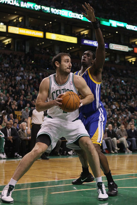 BOSTON, MA - MARCH 04:  Nenad Krstic #4 of the Boston Celtics heads for the net as Ekpe Udoh #20 of the Golden State Warriors defends on March 4, 2011 at the TD Garden in Boston, Massachusetts.  NOTE TO USER: User expressly acknowledges and agrees that, b