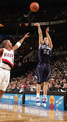PORTLAND, OR - DECEMBER 12:  Raul Lopez #24 of the Utah Jazz shoots a jump shot against the Portland Trail Blazers on December 12, 2004 at the Rose Garden in Portland, Oregon. The Blazers won 98-88. NOTE TO USER: User expressly acknowledges and agrees tha