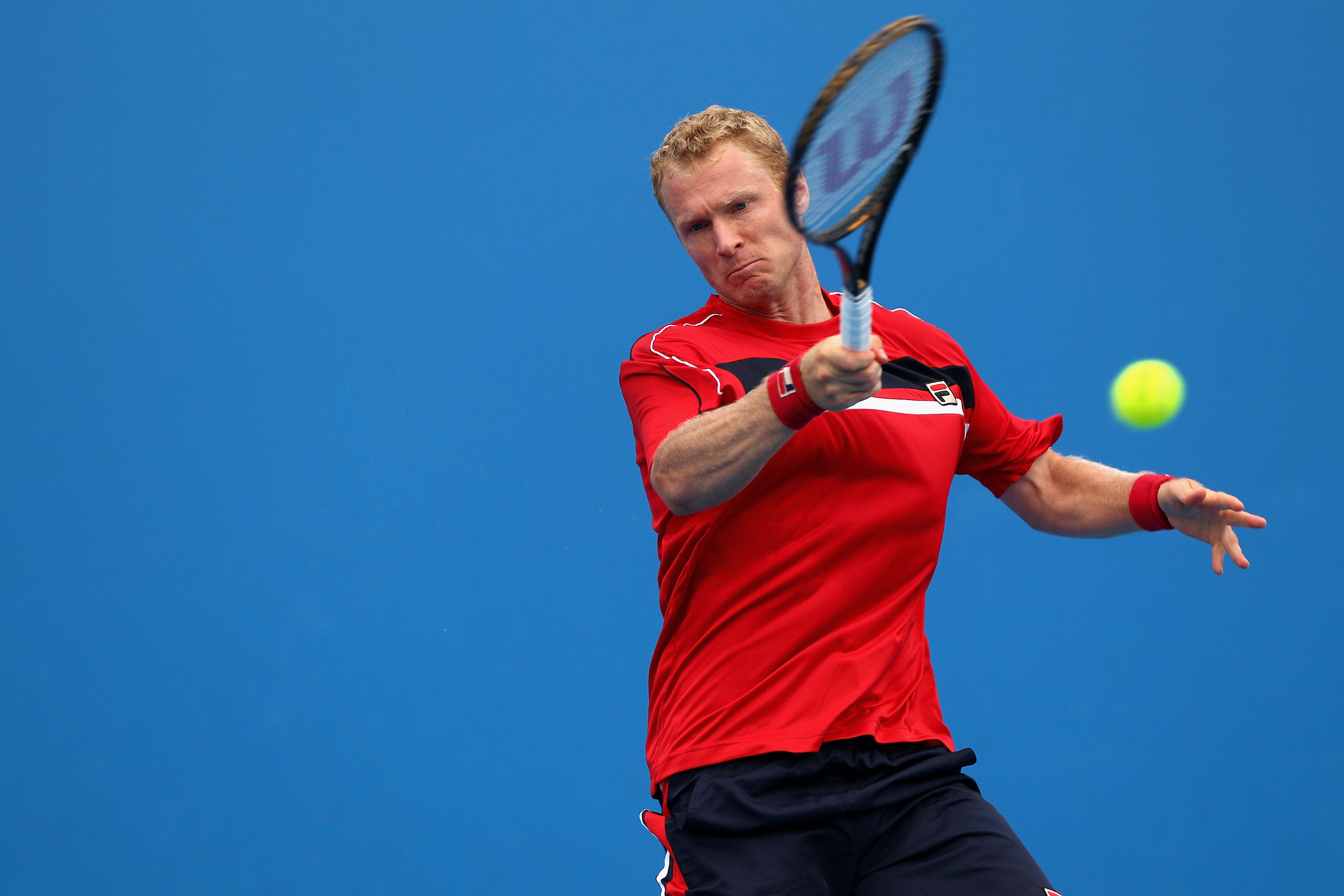 MELBOURNE, AUSTRALIA - JANUARY 17:  Dmitry Tursunov of Russia plays a forehand during his first round match against Viktor Troicki of Serbia during day one of the 2011 Australian Open at Melbourne Park on January 17, 2011 in Melbourne, Australia.  (Photo
