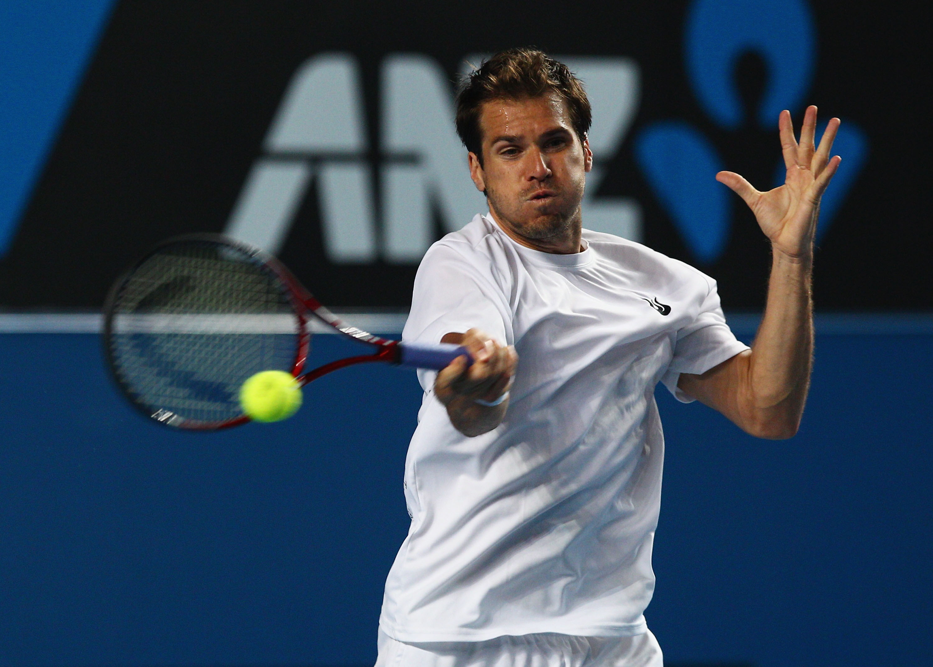 MELBOURNE, AUSTRALIA - JANUARY 23:  Tommy Haas of Germany plays a forehand in his third round doubles match against Jo-Wilfried Tsonga of France during day six of the 2010 Australian Open at Melbourne Park on January 23, 2010 in Melbourne, Australia.  (Ph