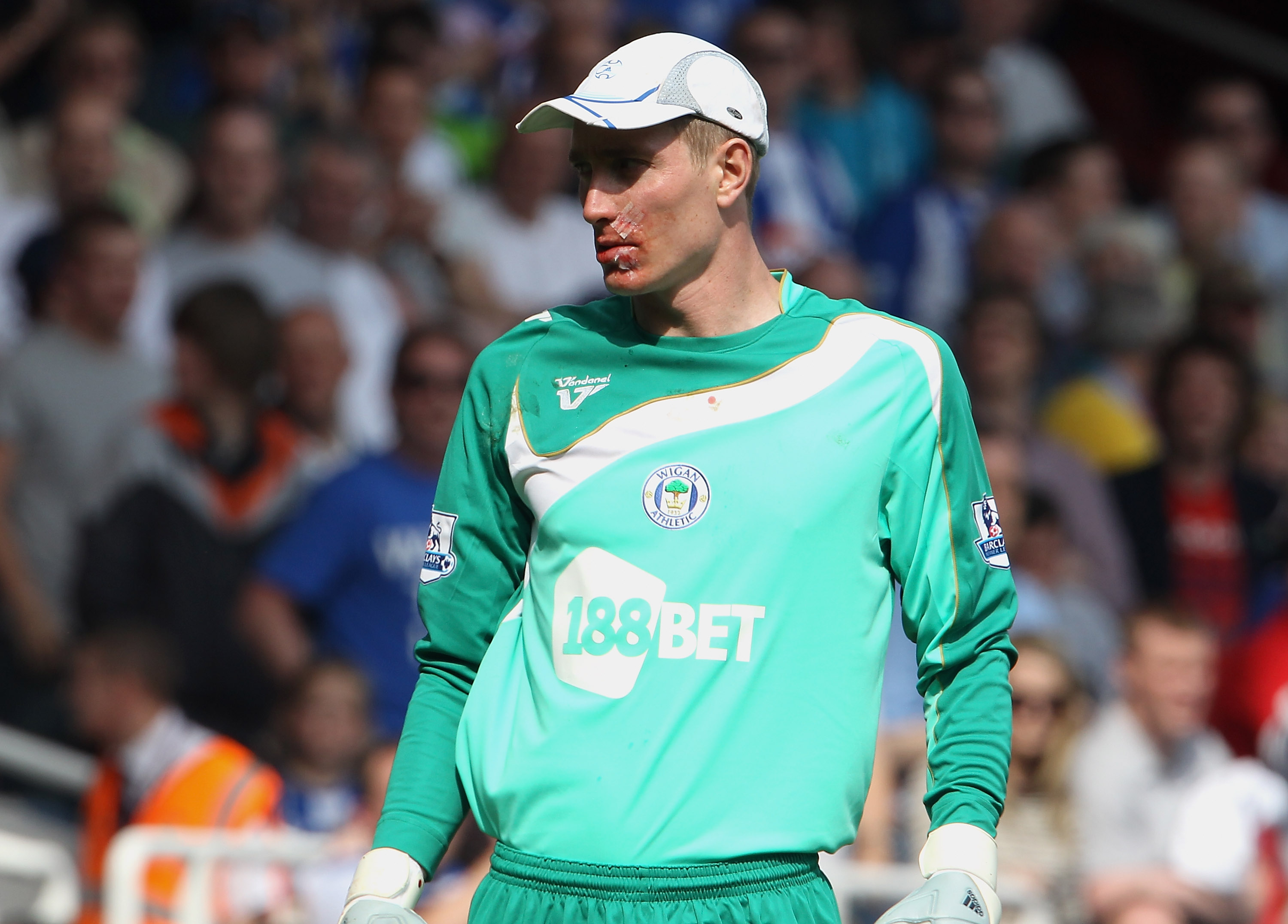 LONDON, ENGLAND - APRIL 24:  Chris Kirkland of Wigan with plasters on his face after being injured by Carlton Cole of West Ham during the Barclays Premier League match between West Ham United and Wigan Athletic at the Boleyn Ground on April 24, 2010 in Lo