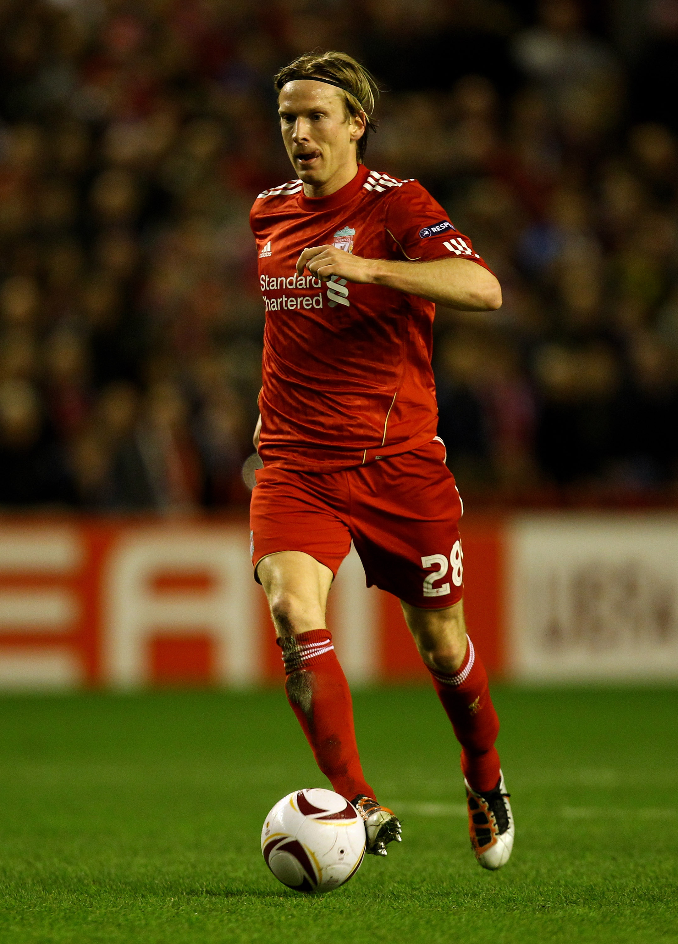 LIVERPOOL, ENGLAND - FEBRUARY 24:  Christian Poulsen of Liverpool in action during the UEFA Europa League Round of 32 2nd leg match beteween Liverpool and Sparta Prague at Anfield on February 24, 2011 in Liverpool, England.  (Photo by Richard Heathcote/Ge