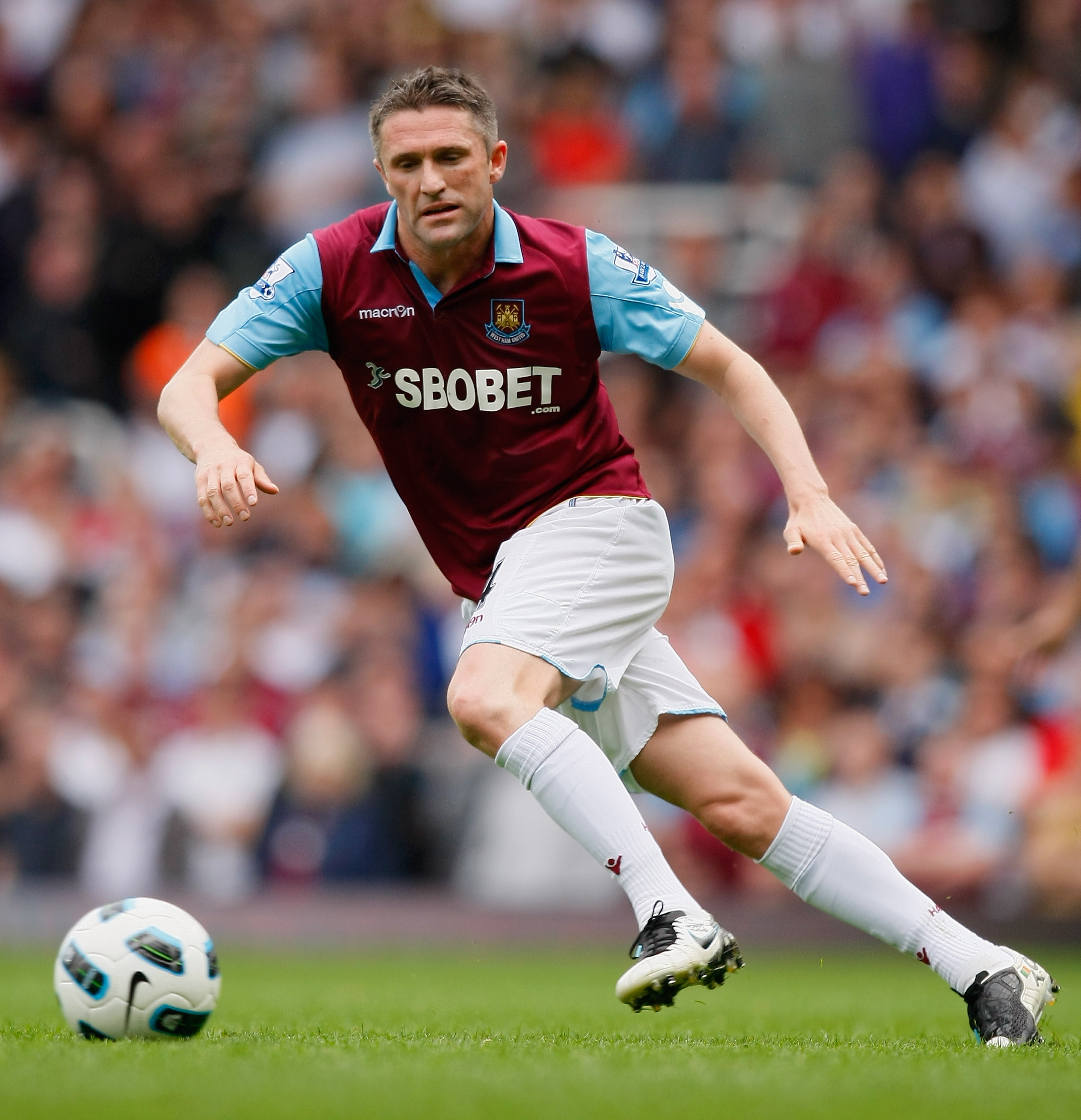LONDON, ENGLAND - APRIL 16:  Robbie Keane of West Ham United runs with the ball during the Barclays Premier League match between West Ham United and Aston Villa at the Boleyn Ground on April 16, 2011 in London, England.  (Photo by Tom Dulat/Getty Images)