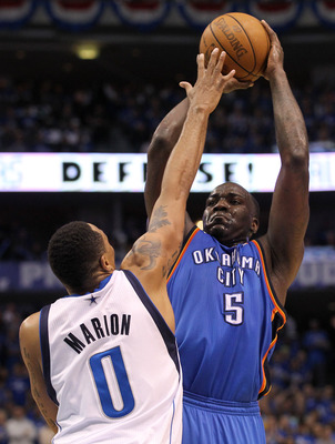 DALLAS, TX - MAY 19:  Kendrick Perkins #5 of the Oklahoma City Thunder shoots over Shawn Marion #0 of the Dallas Mavericks in the third quarter in Game Two of the Western Conference Finals during the 2011 NBA Playoffs at American Airlines Center on May 19