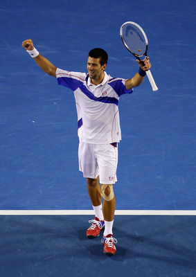 MELBOURNE, AUSTRALIA - JANUARY 30:  Novak Djokovic of Serbia celebrates championship point in his men's final match against Andy Murray of Great Britain during day fourteen of the 2011 Australian Open at Melbourne Park on January 30, 2011 in Melbourne, Au