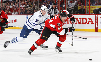 OTTAWA, CANADA - APRIL 2: Jason Spezza #19 of the Ottawa Senators skates with the puck on a break away against Keith Aulie #59 of the Toronto Maple Leafs at Scotiabank Place on April 2, 2011 in Ottawa, Ontario, Canada.  (Photo by Jana Chytilova/Freestyle