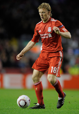 LIVERPOOL, ENGLAND - MARCH 17:  Dirk Kuyt of Liverpool runs with the ball during the UEFA Europa League Round of 16 second leg match between Liverpool and SC Braga at Anfield on March 17, 2011 in Liverpool, England.  (Photo by Michael Regan/Getty Images)
