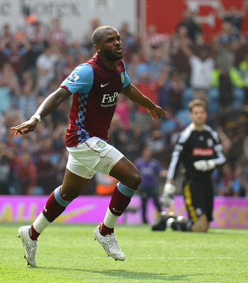 BIRMINGHAM, ENGLAND - APRIL 23:  Darren Bent of Aston Villa celebrates scoring the equaliser during the Barclays Premier League match between Aston Villa and Stoke City at Villa Park on April 23, 2011 in Birmingham, England.  (Photo by Laurence Griffiths/