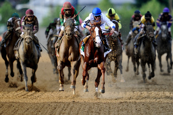 BALTIMORE - MAY 21: Jockey Jesus Castanon riding 'Shackleford' crosses the finish line in first place in the 136th running of the Preakness Stakes at Pimlico Race Course on May 21, 2011 in Baltimore, Maryland. (Photo by Patrick Smith/Getty Images)