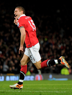 MANCHESTER, ENGLAND - FEBRUARY 01:  Nemanja Vidic of Manchester United celebrates scoring his team's third goal during the Barclays Premier League match between Manchester United and Aston Villa at Old Trafford on February 1, 2011 in Manchester, England.
